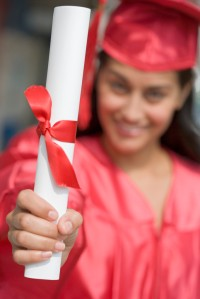 Smiling Graduate Displaying Her Diploma