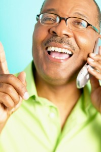 Mature man talking on mobile phone smiling